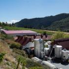 This photograph of Gibbston Valley Winery shows the existing winemaking facility - the barn-like...