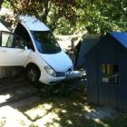 This rental car, containing  two Chinese tourists,  crashed through a fence yesterday and came to...