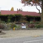 This two-bedroom cottage at Wanaka, with prime lake views, sold at auction for $1.1 million at...