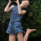 This year's winner, Madeline Bilkey, jumps for joy while holding the Canon EOS 7000 DSLR camera...