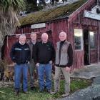 Three of the men who saved Nicol's Blacksmith Shop from demolition, Burns Pollock (left), Bill...