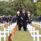 Thurza Batchelor and Ron Bailey walk through the Field of Remembrance in Victoria Park  to honour...