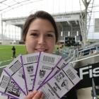 Ticketing assistant Whitney Kooman with tickets for events at Forsyth Barr Stadium. Photo by...