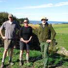 Tim (left) and Janet Penney stand in front of the fence protecting  Waitotaranui Creek with QEII...