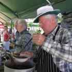 Tim Scurr ladles rabbit stew at the annual Cardrona vintage fair yesterday. Photos by Marjorie Cook.