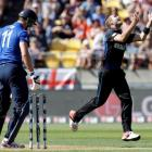 Tim Southee (R) celebrates after dismissing England's Steven Finn during their Cricket World Cup...