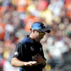 Tim Southee walks off the field after taking seven wickets against England in Wellington. REUTERS...