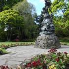 Time flies in the Wonderland gardens in the Oamaru Public Gardens. Photo by Sally Rae.