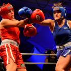 Tina Stevens (right) delivers one of her winning punches  to Anna Esquilant in the Southern...
