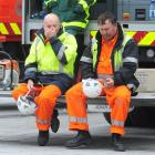 Tired search and rescue workers rest in the Square in Christchurch yesterday.