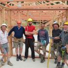 Tirohanga Camp manager Matt Stevenson (fourth from left) builder Darren Edwards (fifth from left)...
