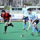 Tom Clarkson (University Blue) looks for opportunities upfield during the Dunedin men's club...