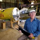 Tom Grant with his Albatros and SE 5a replica World War 1 aircraft. Mr Grant holds a piece of the...