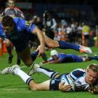 Tom Kingston of the Waratahs dives for a try during the Super Rugby match between the Force and...