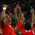 Tonga players celebrate after beating France at Wellington Regional Stadium. REUTERS/Jacky Naegelen