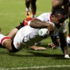 Tonga's Fetu'u Vainikolo scores a try during their Rugby World Cup Pool A match against Japan at...