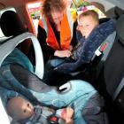 Tonia Scoullar, Otago-Southland Plunket car seat co-ordinator, shows the correct way to put Van...