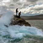 Tony George (left) and Tobias Downie, both from Temuka, fish from a rocky ledge. Photos by...