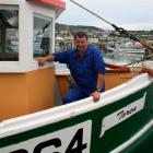 Torea skipper Peter Leask on the boat at Bluff after it was repaired and upgraded last year....