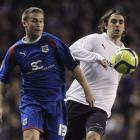 Tottenham Hotspur's Niko Kranjcar, right, competes with Stevenage's Joel Byrom during English FA...