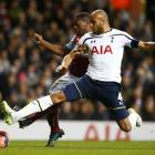 Tottenham Hotspur's Younes Kaboul challenges Burnley's Marvin Sordell during their FA Cup third...