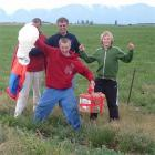 Touch down . . . (from left) Chris Hilder (obscured), Graham Innes, Reuben Hilder (front) and...