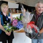 Tourist Peter Hunt is presented with flowers and a gift basket by Toitu Otago Settlers Museum...