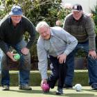 Tournament boss Neill Williams is supported by brothers Jim and Terry Scott as he tests the green...