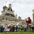 TPP action organiser Jen Olsen addresses a rally against the  Trans Pacific Partnership  outside...