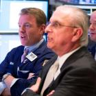 Traders react to the moving price of Facebook shares while waiting for the close of the New York...