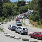 Traffic queues at the single-lane Kawarau Falls Bridge, which is to be replaced. Photo by James...
