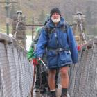 Trail leader Don Morrison leads one of the walking cavalcade trails over the Shaky Bridge and...
