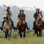 Trent Anderson, Malcolm Gibson and Ben Nielsen-Vold ride home from a day's work on Mt Nicholas...