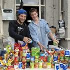 Trent Davis (left) and Michael Mitchell with items they have collected for Dunedin foodbanks....