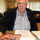Trevor Hobbs, of Invercargill, reads information about his  great-uncle Albert (Bert) Appelbe....