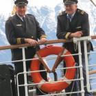 """TSS Earnslaw skipper Laurie Stanton (left) and senior skipper Graham """"Twinny"""" Moore-Carter stand..."""