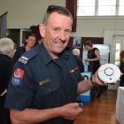Firefighter Richard Yardley explains fire risk to senior citizens.  Photo by Gregor Richardson.