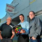 Tuapeka Gold Print director Jim Robertson (left), general manager Greg Jolly (centre)  and...