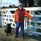 Tuapeka Punt operator Peter Dickson, with his dog Mission (7), has been ferrying people and cars...