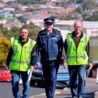 Tubby Hopkins (left) and Ian Corry, of the Dunedin South Community Patrol, are joined by  Senior...