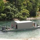 Two days later than planned, Cold Gold Clutha Ltd's dredge is finally on the Clutha River. Photo...