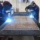 Two prisoners working in the Otago Corrections Facility weld steel bunks to be installed in the...