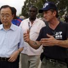 U.N Secretary-General Ban Ki-moon, left, listens to US actor Sean Penn during his visit to a...