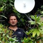 Unifone managing director Travis Baird installs an internet receiver at the offices of the...