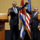United States President Barack Obama and Cuban President Raul Castro gesture after a news...