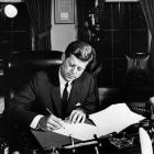 United States president John F. Kennedy signs a proclamation authorising the naval blockade of...