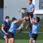 University A loose forward Jack Wolfreys is supported by team-mates Angus Williams (left) and...