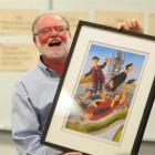 University of Otago mathematician Prof Derek Holton holds a print, by artist Frank Gordon,...
