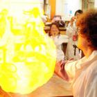 University of Otago PhD chemistry student John Cubanski's flame-covered hand ignites a balloon...