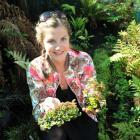 University of Otago postgraduate wildlife management student Kelly Frogley (23) holds samples of...